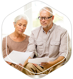 Older couple looking over their home equity loan documents to determine what errors it may contain