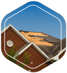 House with missing roof due to windstorm damage is in need of help with homeowner's insurance claim