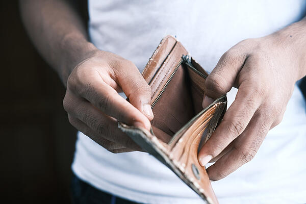 person-holding-empty-wallet