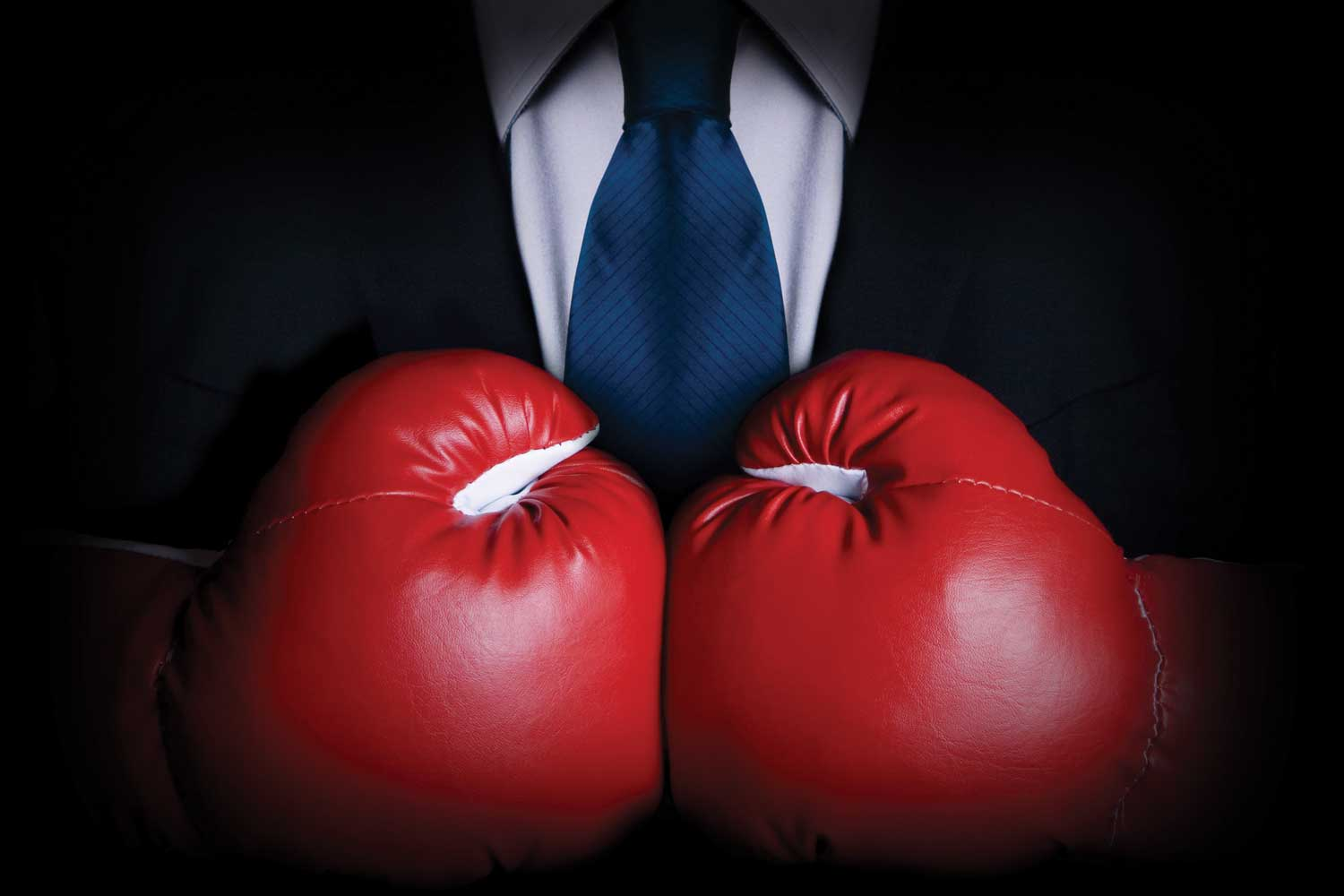business suit and boxing gloves