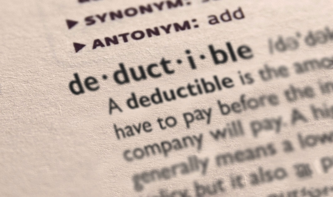 Dictorary page showing the definition of deductible