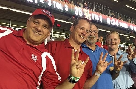 Team at a UH game - Go Coogs!